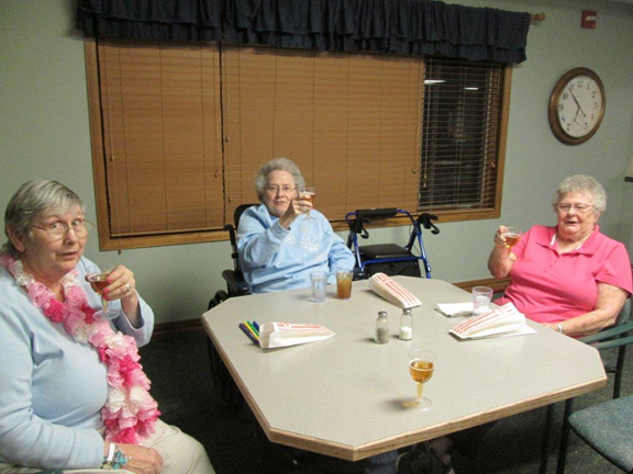 Residents of Highland Park Care Center enjoy Naked wine and snacks.