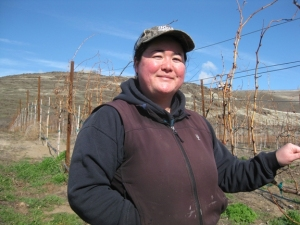 Kimiko Atkins with mourvedre vines near Maryhill, Wash.
