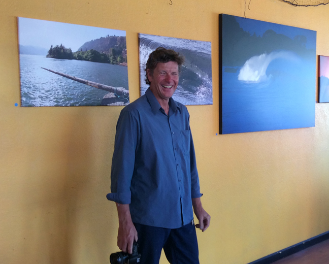 Grant Myrdal and some of the photographs on show at the Naked Winery tasting room in Hood River.