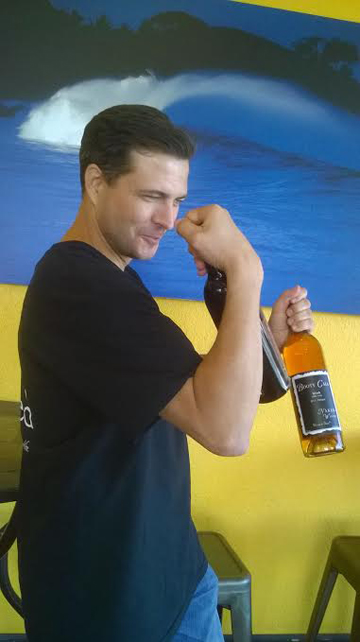 Nick West, buffin' those guns with bottles from Naked Winery.